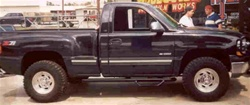 N-Fab's Wheel-to-Wheel Nerf Steps for '99-'06 Chevy/GMC C1500/C2500 Regular Cab Long Bed