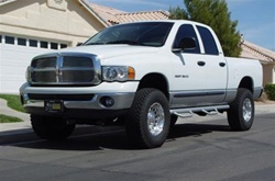 N-Fab's Wheel-to-Wheel Nerf Steps for '97-'01 Dodge Ram Quad Cab 4 Door Long Cab