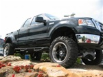 N-Fab's Wheel-to-Wheel Nerf Steps for '04-'08 Ford F150 Quad Cab Short Bed