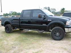 N-Fab's Wheel-to-Wheel Nerf Steps for '87-'97 Ford F250/F350 Crew Cab Long Bed