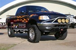 N-Fab's Wheel-to-Wheel Nerf Steps for '97-'99 Ford F150 Extra Cab 3 Door Short Bed