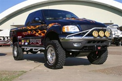 N-Fab's Wheel-to-Wheel Nerf Steps for '97-'03 Ford F150 Extra Cab 4 Door Short Bed