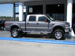 N-Fab's Stainless Steel Wheel-to-Wheel Nerf Steps for '99-'09 Ford F250/F350 Crew Cab Short Bed