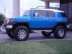 "N-Fab's Stainless Steel Wheel-to-Wheel Nerf Steps for '04-'09 Toyota FJ Cruiser 2"" Main Tube"
