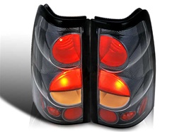 99-06 Chevy Silverado Altezza Tail Light, Carbon/Clear, by Winjet