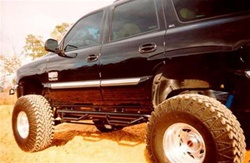 N-Fab's Wheel-to-Wheel Nerf Steps for '01-'06 Chevy/GMC Tahoe 4-Step
