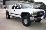 N-Fab's Wheel-to-Wheel Nerf Steps for '99-'06 Chevy/GMC C2500/C3500 Quad Cab Long Bed