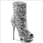 These New York fashion boots are styled with silver sequins and feature rhinestone accents in the mid-platform of these full inner side zipper midcalf boots.