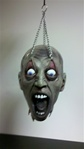 Hanging Severed Zombie Head - Eyelid Kid