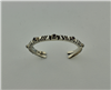 narrow handcrafted carved sterling silver bracelet with garnets
