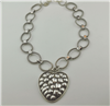 Handcrafted silver chain with repousse silver heart pendant
