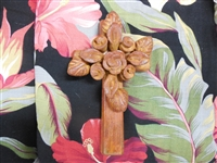 7 3/4 inch rustic clay cross from Mexico. Flowers may be different from the picture as each artist makes his own.