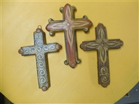 Three complimentary crosses, one favoring the reds, another yellow and the last black. all in traditional Tonala decor