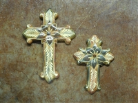 A large 8 3/4inch clay cross and smaller 7 inch cross. Both painted with a white leaf design traditional style of Mexico. In the center there is a 3 diminsional tin cross.