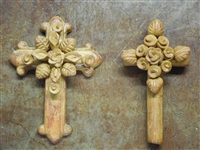 Two clay cross one 8 inches round tube and center floral pattern the other 8 1/2 inches fleur de lis tips and center floral pattern