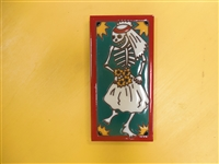 A beautiful tile Day of the Dead Dancing Bride. Red Border and teal accents, yellow highlights, on a black background. Start your collection.