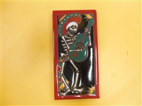 A beautiful tile Day of the Dead Mariachi Guitar Player. Red Border and teal accents, yellow highlights, on a black background. Start your collection.