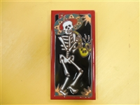A beautiful tile Day of the Dead mariachi Sax Player. Red Border and teal accents, yellow highlights, on a black background. Start your collection.
