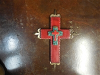 17 inches long. Wood cross with rippled edges aged to look rustic. Smaller wood  cross on top with a medium Mexican tile cross on top and aged tin tips