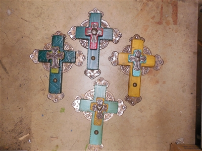 A 15 x 11 1/2 inch medium wood cross with rippled edges and full tin background accented by a Haiti cross on the center.