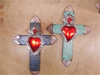 A 15 x 11 inch medium wood cross with grind marks and tin tips accented by a Mexican tin heart on the center.