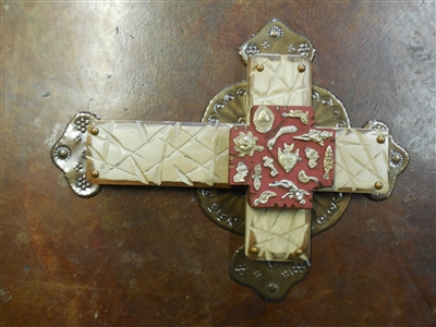 A 15 x 11 1/2 inch medium wood cross painted and distressed and full tin background and a red Milagro cross in the center.