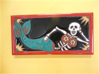 A beautiful tile Day of the Dead Muerto Mermaid. Red Border and teal accents, yellow highlights, on a black background. Start your collection.