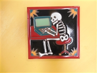 A 6 x 6 high fired Day of the Dead Tile. A skeleton sits in front of the computer waiting for a download. Red Border and black background. This tile can be installed in an architectural Design