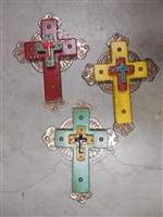 A 15 x 11 1/2 inch medium wood cross with rippled edges and full tin background accented by a Mexican tile cross on the center.