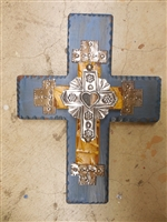 Larger wood cross with rippled edges and a smaller rustic cross on top.  A shiny tin cross with heart mirror high lights the middle.