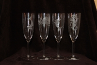 A delicate champagne glass etched in Hammerhead Shark or Seahorse, or Sailfish, or Octopus