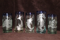 5 etched blue rimmed shot glasses with a sea turtle, sail fish, octopus, hammerhead shark and seahorse
