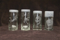 White rim hand blown tequila shot glass etched with fun skeletons.