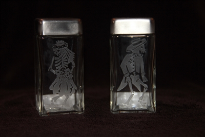 Salt and Pepper etched with Day of the Dead happy skeletons by Debbie Fuentes