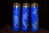 3 blue candles with a sail fish, hammerhead shark and seahorse etchings