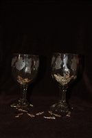 Wine glass with milagros etched all around the edge