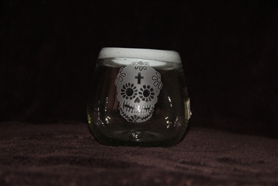 A round hand blown Mexican bubble glass that sits in the palm of your hand like a pet bird. Sip away at your very best tequila. The white rim makes it unique. The art and deep etching make it a Joy.