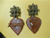 Approx. 9  inch rustic clay hearts from Mexico. Flowers may be different from the picture as each artist makes his own. one is for Holy Water and the other is a Sacred Heart with thorns