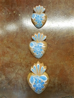 Set of Three Clay Sacred Hearts Hand painted in the traditional floral pattern of Mexico. Available in turquoise or Cobalt blue