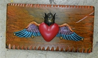 A winged Heart with crown. Framed by a rustic  frame and clavos