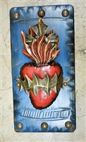 Dramatic Mexican Tin Sacred Heart. Framed by a rustic blue frame and clavos