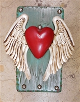 White Winged Flying Heart. Framed by a rustic turquoise frame and clavos