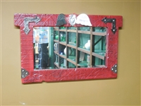 Rustic wood painted Red mirror. Beveled mirror with blemishes. Aged tin arrows on corners with a Mexican Flying Heart on top. Approximately 30 x 25 inches
