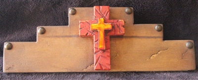 A wood rug rail with a small painted and rustic grind marks cross and matching tile cross in the center. Used to hold your hand made weaving or quilts with pressure