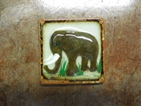 Elephant on both sides of a tile box candle. assorted colors of wax. No scent