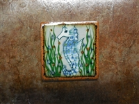 Blue Sea Horse on both sides of a tile box candle. Assorted colors of wax. No scent