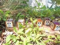 Tile box candles. Original art by Debbie Fuentes. Manufactured in Mexico. 2 x 2 inch Mini Sugar Skull design