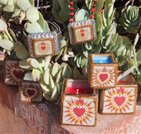 Medium tile box candles with Sacred Heart. Green, red or yellow wax. Designed by Debbie Fuentes and made in Mexico