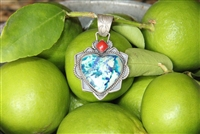 American made from New Mexico. A silver pendent with Balboa Blue stone and a coral accent.