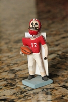 Clay Day of the Dead Football Player. 3 1/2 inches tall, red Jersey #12. Made in Mexico